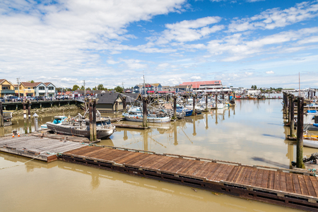 RICHMOND, CANADA - JULY 10: Colorful boats and trawlers dock at the seaside village of Steveston Fisherman's Wharf in Richmond near Vancouver July 10, 2016. A 19th-century frontier seaport more than 100 years ago, the place has become a picturesque commer Sajtókép