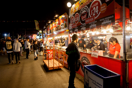 night market: RICHMOND, CANADA - JULY 10: Visitors at the Richmond night market near Vancouver enjoying food and fun July 10, 2016. The market attracts visitors from around the world for its ethnic food, unique shops and nightly street entertainment.