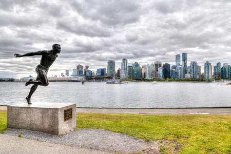 VANCOUVER - JULY 11: The Harry Jerome statue watches over the shores at Stanley Park July 11, 2016 in Vancouver. The popular place was the citys first public park when it incorporated in 1886. Editorial