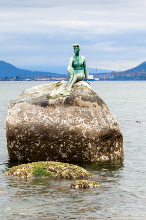 Girl in Wetsuit statue at Stanley Park, Vancouver. The statue represents Vancouvers dependence on the sea.