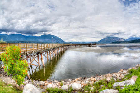 wharf: HDR rendering of Salmon Arm wharf on a cloudy morning. The wharf is the longest wooden wharf in North America.