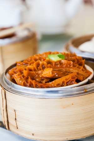 Braised beef tripe dim sum in bamboo steamer is a popular dish in Cantonese restaurants in Hong Kong.