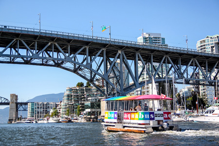 vancouver island: Vancouver, Canada - July 26, 2010: An Aquabus ferry approaches Granville Island Bridge on False Creek in downtown Vancouver. The popular water taxi service around Granville Island and False Creek destinations.