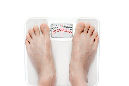 signifies: Feet on mechanical bathroom scale with the word UNDERWEIGHT on screen. Signifies eating disorder problems requiring proper treatment.