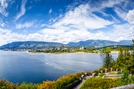 Vancouver skyline panorama taken at Prospect Point, Stanley Park, showing Lions Gate Bridge on right and West Vancouver on the left. Prospect Point is located on the south side of the First Narrows of Burrard Inlet