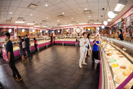Vancouver, Canada - July 11, 2016: Customers at the famous La Casa Gelato shop in Vancouver. It is renowned as the only ice cream shop in the world to carry 238 flavours on location at a time.