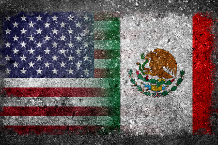 Merged Flag of USA and Mexico painted on grunge concrete. Concept of Donald Trump's US immigration policy to erect concrete wall along Mexico border. Imagens - 73746469