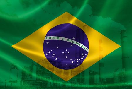 Rendement 3D du drapeau du Brésil sur le satin soyeux et double exposition des piles de fumée d'usine en arrière-plan, ce qui signifie le grave problème de pollution de l'industrie au Brésil. Le Brésil est l'un des pays les plus polluants au monde. Banque d'images - 74556003