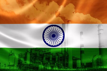 double exposure: 3D rendering of Indias flag on silky satin and double exposure of factory smoke stacks in the background, signifying the serious industry pollution problem in India. India is one of the most polluting countries in the world.