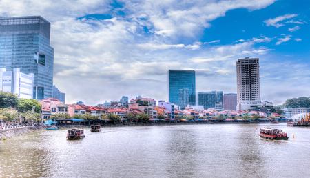riverbank: Colorful bars and restaurants dot the Singapore River along Boat Quay. The area used to be a commercial center during the colonial era where warehouses are located. Now, it is full of bars and restaurants for locals and tourists alike. HDR rendering.
