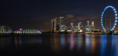 A panorama of Singapores skyline at night on the Marina Bay.