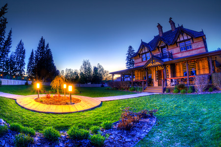 Calgary, Canada - May 2, 2016: Sunset at Ranche House inside Fish Creek Provincial Park. Built in 1896, the historic brick house was an iconic symbol of Calgary where wealthy socialites meet. Today, the place has been converted into a restaurant. HDR rend