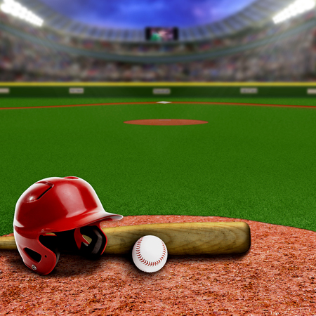 Baseball stadium full of fans in the stands with baseball helmet, bat and ball on infield dirt clay. Deliberate focus on equipment and foreground with shallow depth of field on background. Floodlights flare for effect and copy space. Stock Photo