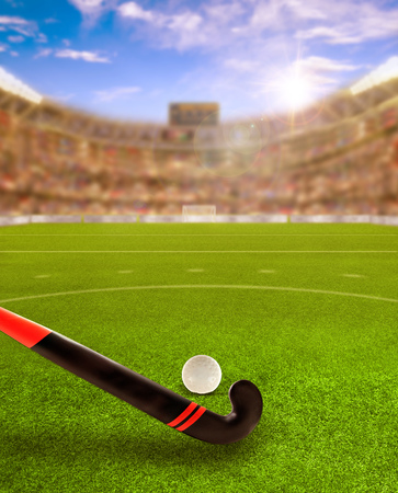 3D rendering of sports arena full of fans in the stands with field hockey stick and ball on field. Sunset flare for special effects. Focus on foreground and copy space.