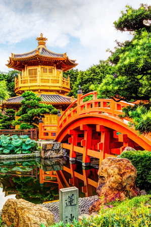 HDR rendering of Nan Lian Garden, a Chinese Classical Garden in Diamond Hill, Hong Kong. The public park has an area of 3.5 hectares and was designed after the Tang Dynasty style of architecture. Vertical orientation. Stock Photo
