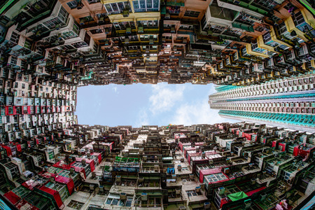 Fisheye view of over-crowded housing in Hong Kongs old residential district of Quarry Bay. With a population of over 7 million, Hong Kong is one of the most densely populated areas in the world.