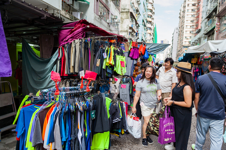 where to go: HONG KONG - July 7, 2017: Fok Wing Street, or Toy Street, in Sham Shui Po is a popular street market where visitors go to shop for cheap fashionable clothing, toys and local street foods.