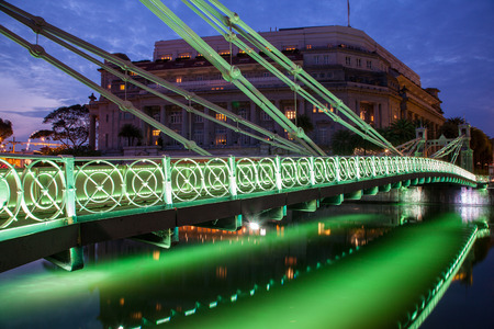 appointed: Brightly lit Cavenagh Bridge is one of the oldest bridges and the only cable-stayed suspension bridge in Singapore, spanning the lower reaches of the Singapore River. Opened in 1870, it was named after William Orfeur Cavenagh, the last India-appointed Gov