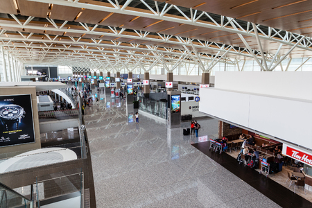 CALGARY, CANADA - AUGUST 30, 2017: Passengers at the international terminal of Calgary International Airport. Opened in 1938, the airport offers non-stop flights to major cities in North America, Europe and East Asia.