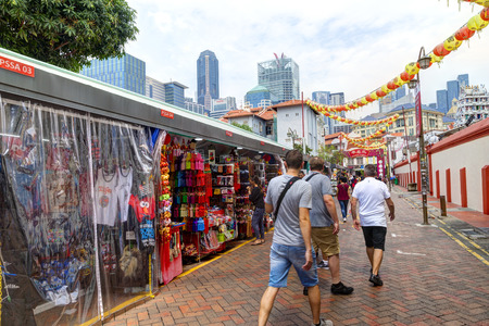 SINGAPORE - SEPTEMBER 11, 2017: Shoppers visiting Chinatown for bargain souvenirs and authentic local food. The old Victorian-style shophouses are a trademark of this popular area. Singapore's Chinatown was originally designated for Chinese settlement by  Stock fotó - 86659154