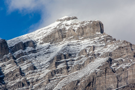 Focus on the summit of Cascade Mountain in the Bow River Valley of Banff National Park. At 9,836 feet, it is the highest mountain in the town of Banff and popular among hikers and mountain climbers.