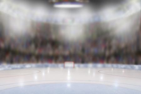 Lage hoekmening van fictieve hockeyarena met sportenventilators in de tribunes. Focus op de voorgrond met opzettelijke ondiepe scherptediepte op de achtergrond.