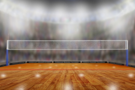 Low angle view of fictitious volleyball arena with sports fans in the stands and copy space. Focus on foreground with deliberate shallow depth of field on background.