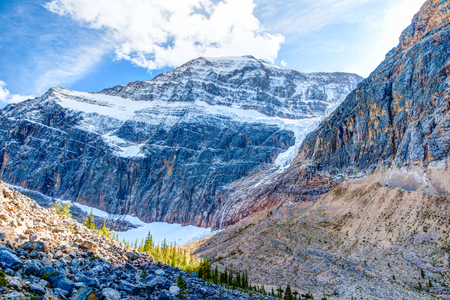 Mount Edith Cavell, a mountain located in the Athabasca River and Astoria River valleys of Jasper National Park in Alberta, Canada. The famous Angel Glacier can be seen on the north face of the mountain.