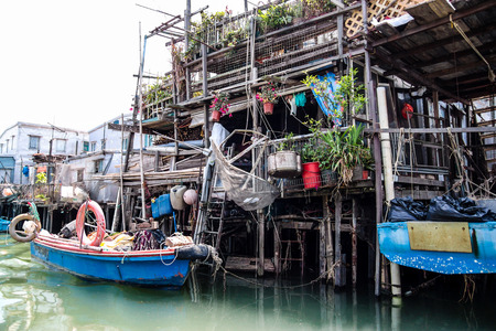 Rows of traditional wooden stilt houses in Tai O, a fishing town on western Lantau Island in Hong Kong.