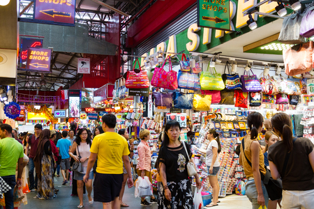 SINGAPORE - SEPTEMBER 7 ,2017: Shoppers at the famous Bugis Street Market, a bargain place renowned for cheap food; clothing, souvenirs, electronics, houseware and cosmetics.