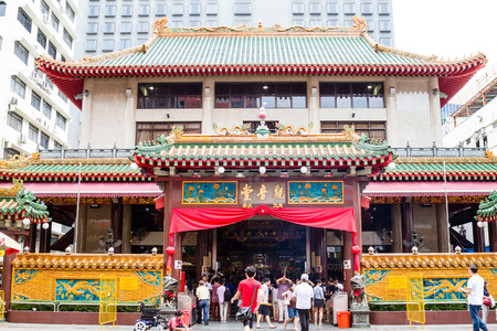 SINGAPORE - SEPTEMBER 7, 2017: Worshippers flock to the historical Kwan Im Thong Hood Cho Temple on Waterloo Street during the Hungry Ghost Festival. Since 1884, this Chinese Goddess of Mercy temple has attracted devotees to worship from around the world.