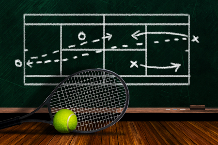 Tennis racket and ball on table with background players doubles strategy on chalkboard and copy space. Stok Fotoğraf