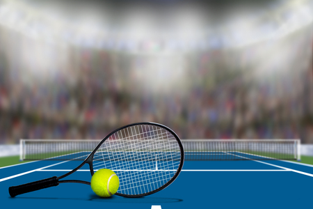 Low angle view of Tennis court full of spectators in the stands with copy space. Deliberate focus on foreground with shallow depth of field on background.