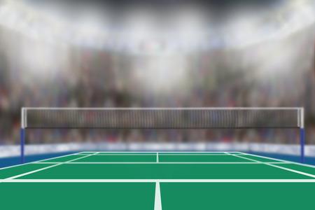 Opinião de baixo ângulo da arena do badminton com os fãs de esportes nos suportes e no espaço da cópia. Focalize no primeiro plano com profundidade de campo rasa deliberada no fundo.