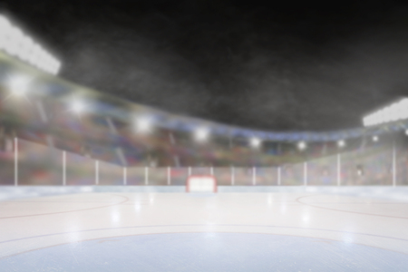 Brightly lit outdoor ice hockey rink arena with focus on foreground and shallow depth of field on background. Deliberate lens flare and copy space.
