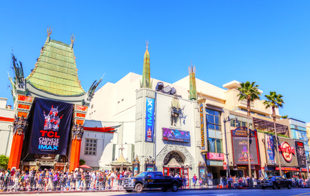 LOS ANGELES - MAR 26, 2018: Crowds gather at the famous Graumans Chinese Theater on Hollywood Boulevard. Declared a historic-cultural landmark in 1968, it is the world's largest IMAX auditorium.