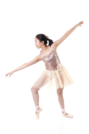 Young Asian ballerina making a ballet pointe movement. Isolated on white background.