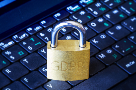 Golden padlock with GDPR engraved on computer laptop keyboard. Concept of General Data Protection Regulation (GDPR) in the European Union.