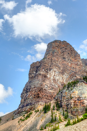 Towering Mount Babel near Lake Louise in Alberta, Canada. Nicknamed Tower of Babel, it has an elevation of 2,360 meters or 7,743 feet and is one of the popular hiking spots inside Banff National Park.