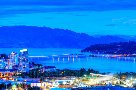 Sunset blue hour on Knox Mountain showing William R. Bennett Bridge linking downtown Kelowna to West Kelowna across the Okanagan Lake.