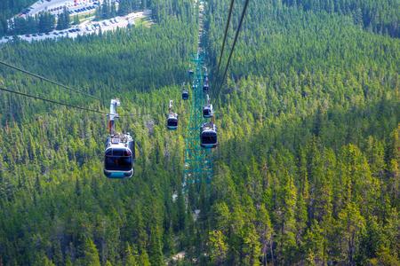 Riding a gondola cable car up Sulphur Mountain in Banff National Park, Alberta, Canada.