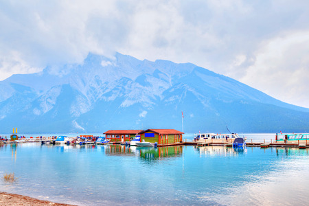 Boat dock on Lake Minnewanka in Banff National Park inside the Canadian Rockies of Alberta, Canada. Stock Photo
