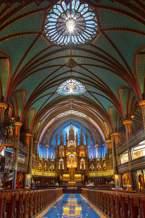 MONTREAL, CANADA - AUG 20, 2012: Interior of the historic Notre-Dame Basilica in Montreal, Quebec, Canada. A national historic site of Canada, the gothic-style Church was the largest in North America  報道画像