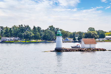 Historic Sunken Rock Lighthouse in Bush Island on the St. Lawrence River in the 1000 Islands region of Alexandria Bay, New York, USA. First built in 1847, it was later converted to solar powered lighthouse in 1988.