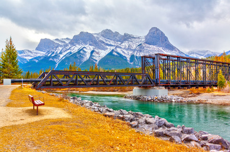Historic Canmore Engine Bridge is a truss bridge over the Bow River in the Canadian Rockies of Alberta. The bridge was built by the Canadian Pacific Railway in 1891 to serve a coal mine. The old rail spur line is now the Bow River hiking loop trail in Canmore.