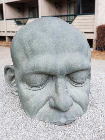 CANMORE, CANADA - OCT 26, 2018: The granite Big Head Sculpture is the most iconic symbol of Canmore Kananaskis in the Canadian Rockies of Alberta. It has become a symbol of the town since its installation in 2008.