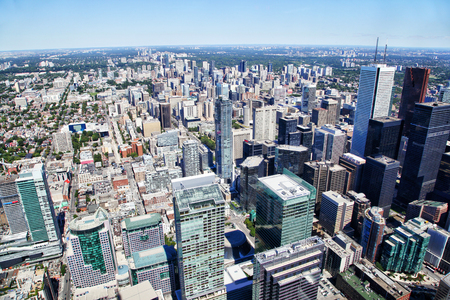 Aerial view of Toronto's downtown financial district showing skyscaper skyline of corporate business buildings.