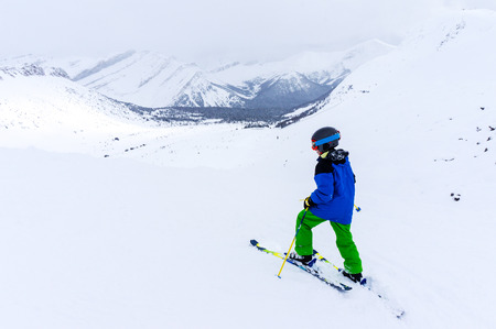 Young skier skiing in the backcountry of a mountain range near Lake Louise in the Canadian Rockies of Alberta, Canada. Stock fotó