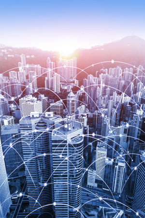 Modern urban skyline with high-speed data and internet communication network. Concept of cyber network in big city with copy space. Vertical orientation. Stock Photo