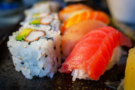Delicious Japanese nigiri sushi bento with Tuna Toro, Tuna Ahi, Salmon Sake, Yellowtail Hamachi, Shrimp Ebi, and California roll.
